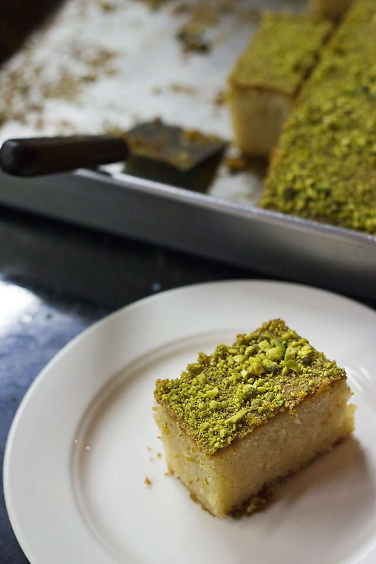 Harissa-Basboussa, a semolina cake with almonds, flavored with orange blossom water and topped with pistachios, at Cafe Zitouna on the corner of Sutter and Polk Streets in San Francisco, CA Thursday evening, October 20, 2011. Photo by Erin Lubin/Special to Chronicle