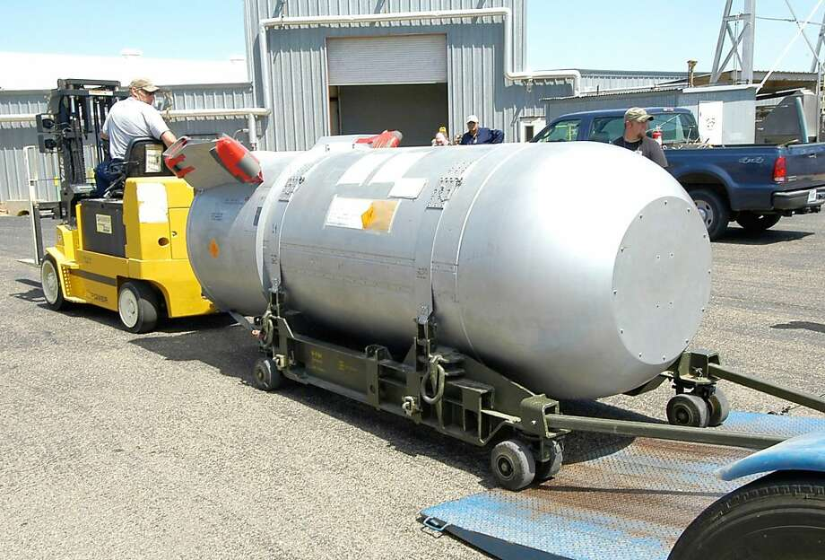 """This undated handout image courtesy of the US Department of Energy shows workers moving a B53 bomb at the Pantex Plant in Amarillo, Texas. The last of the nation's most powerful nuclear bombs - a weapon hundreds of times stronger than the bomb dropped on Hiroshima - is being disassembled nearly half a century after it was put into service at the height of the Cold War. The final components of the B53 bomb will be broken down October 25, 2011 at the Pantex Plant, the nation's only nuclear weapons assembly and disassembly facility. The completion of the dismantling program is a year ahead of schedule, according to the U.S. Department of Energy's National Nuclear Security Administration. Thomas D'Agostino, the nuclear administration's chief, called the bomb's elimination a """"significant milestone.""""    AFP PHOTO/HO/ US Department of Energy                             = RESTRICTED TO EDITORIAL USE - MANDATORY CREDIT """"AFP PHOTO / US Department of Energy  """" - NO MARKETING NO ADVERTISING CAMPAIGNS - DISTRIBUTED AS A SERVICE TO CLIENTS = (Photo credit should read HO/AFP/Getty Images) Photo: Ho, AFP/Getty Images"""