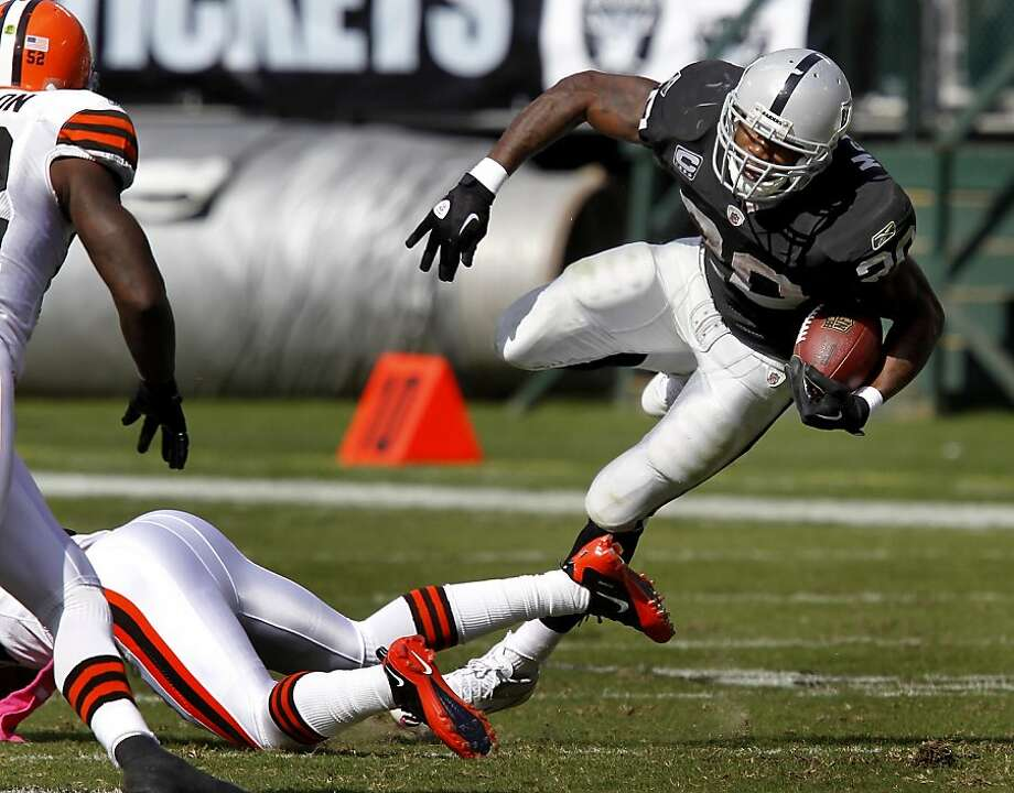 Darren McFadden made a gain in the first half. The Oakland Raiders defeated the Cleveland Browns 24-17 at O.co Coliseum on Sunday October 16, 2011. Photo: Brant Ward, The Chronicle