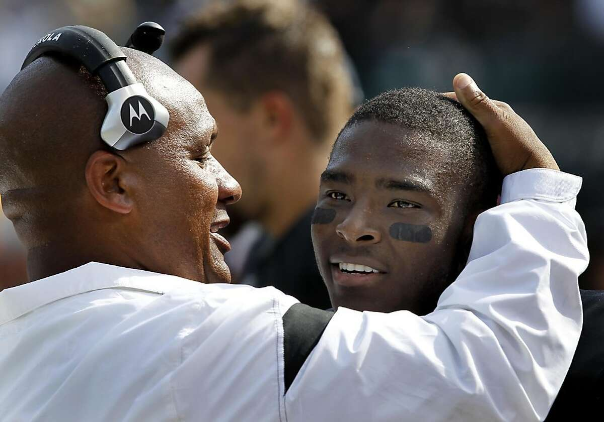 Raiders head coach Hue Jackson hugs Jacoby Ford after his first half touchdown. The Oakland Raiders defeated the Cleveland Browns 24-17 at O.co Coliseum on Sunday October 16, 2011.