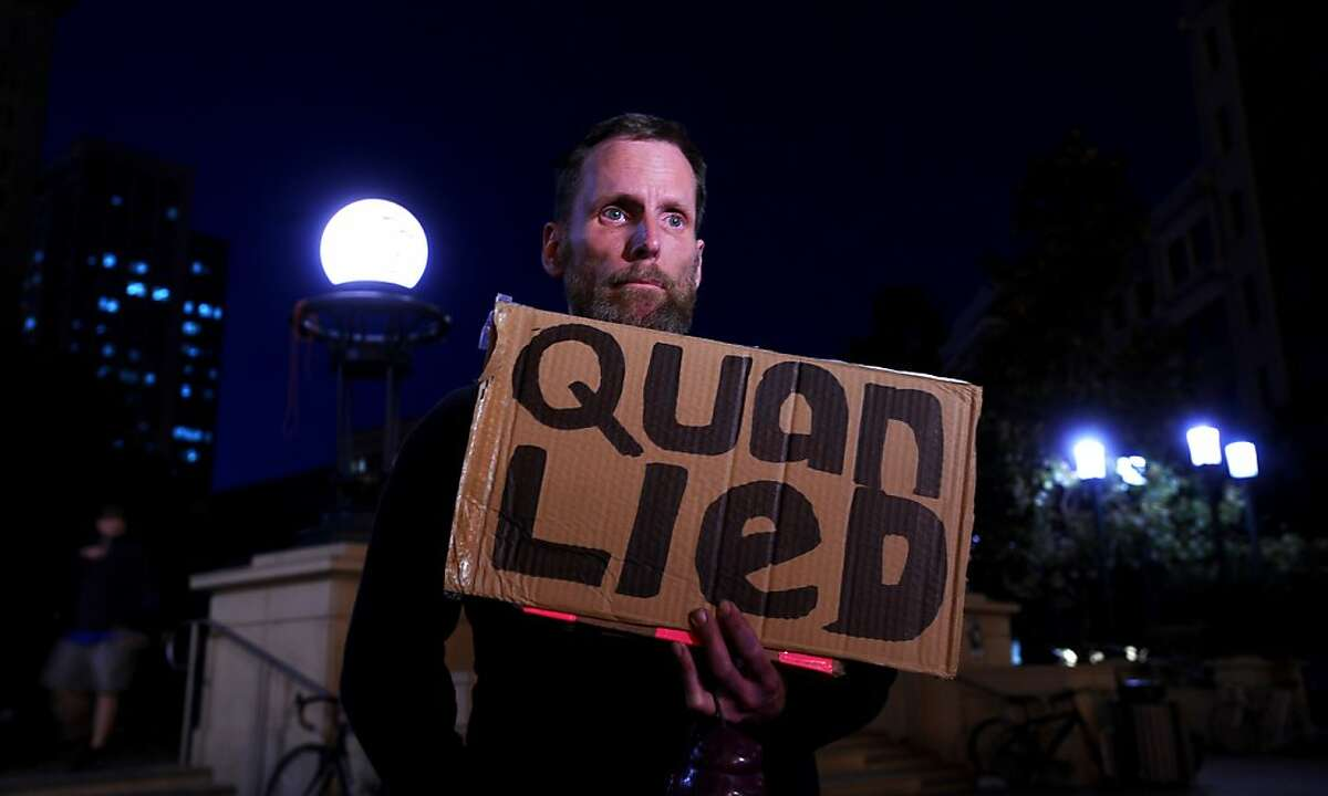 San Francisco resident Phil Horne holds a sign criticizing Oakland Mayor Jean Quan while standing outside city hall in Oakland, Calif. on Thursday, Oct. 27, 2011. The mayor has come under fire for her handling of Occupy Oakland demonstrators. (AP Photo/Noah Berger)