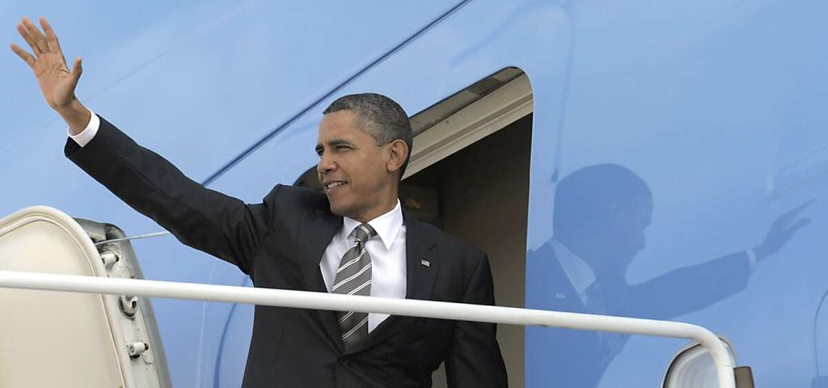 President Barack Obama waves before boarding Air Force One at Andrews Air Force Base in Md., Monday, Oct. 24, 2011. Obama is heading on a three-day trip to the West Coast. (AP Photo/Susan Walsh) Ran on: 10-25-2011 President Obama boards Air Force One for his western fundraising trip.
