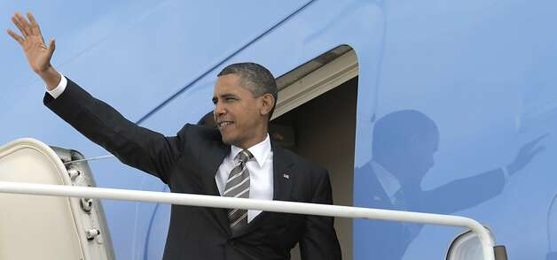 President Barack Obama waves before boarding Air Force One at Andrews Air Force Base in Md., Monday, Oct. 24, 2011. Obama is heading on a three-day trip to the West Coast. (AP Photo/Susan Walsh)  Ran on: 10-25-2011 President Obama boards Air Force One for his western fundraising trip. Photo: Susan Walsh, AP