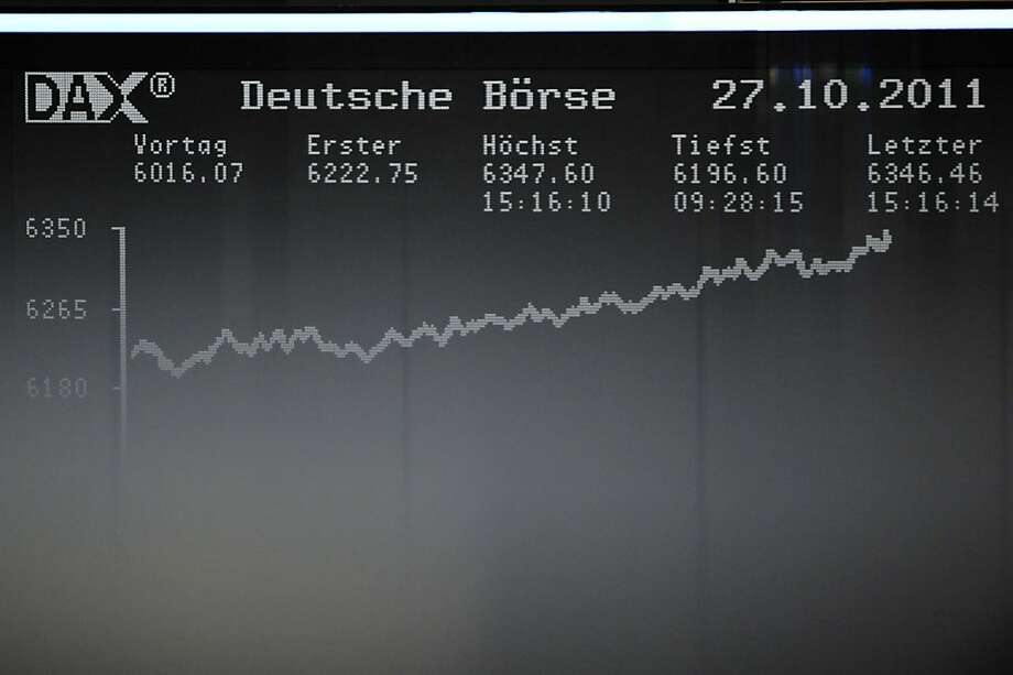 A screen shows the German DAX index in Frankfurt am Main on October 27, 2011 at the German Stock Exchange. German stocks opened sharply higher today after EU leaders sealed a deal to contain the eurozone debt crisis at a summit in Brussels. AFP PHOTO / MARC TIRL +++ GERMANY OUT (Photo credit should read MARC TIRL/AFP/Getty Images) Photo: Marc Tirl, AFP/Getty Images