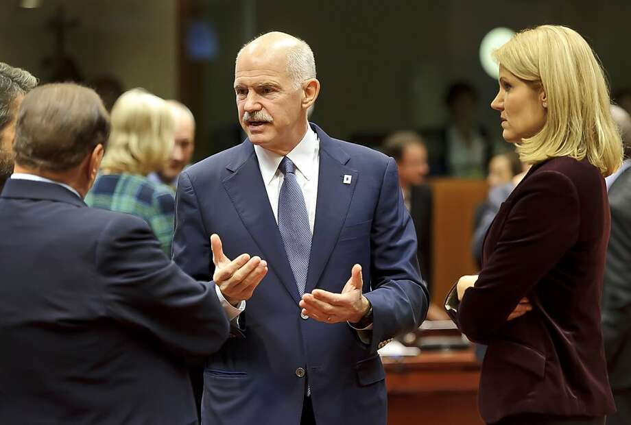 """George Papandreou, Greece's prime minister, center, speaks with Silvio Berlusconi, Italy's prime minister, left, and Helle Thorning-Schmidt, Denmark's prime minister, during a European Council summit to solve Europe's debt crisis at the European Council headquarters in Brussels, Belgium, on Wednesday, Oct. 26, 2011. """"The world is watching Europe and Germany,"""" Germany's Chancellor Angela Merkel said in a speech today to the lower house in Berlin, the Bundestag. Photographer: Jock Fistick/Bloomberg *** Local Caption *** George Papandreou; Silvio Berlusconi; Helle Thorning-Schmidt Photo: Jock Fistick, Bloomberg"""
