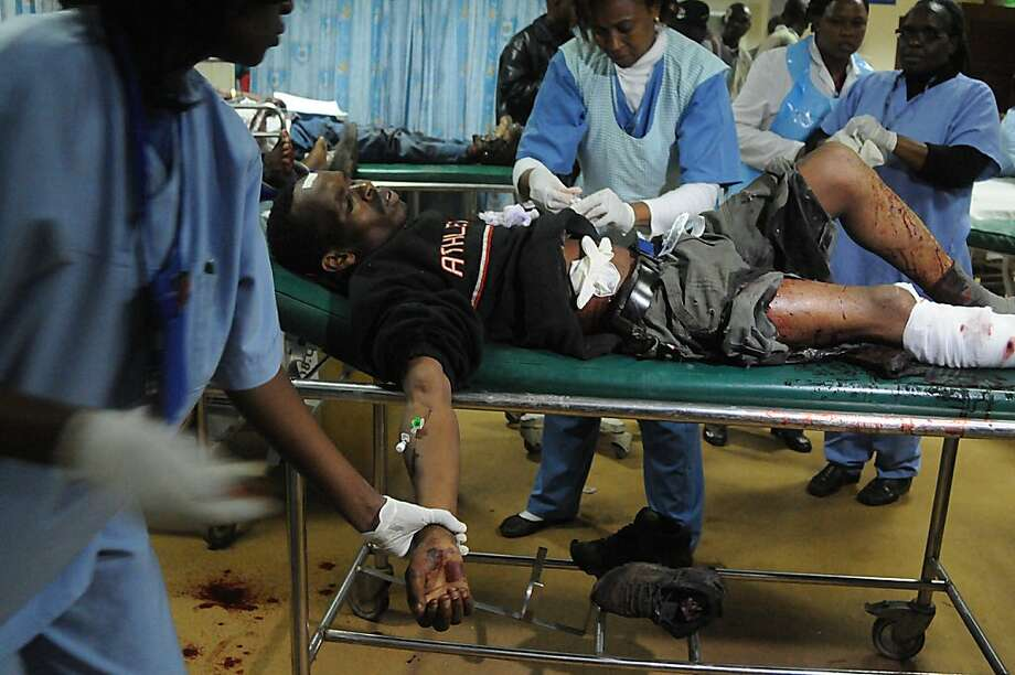 A Kenyan man receives medical treatment at the Kenyatta national hospital following a grenade attack in Nairobi on October 24, 2011.The grenade explosion in the centre of Nairobi on Monday evening killed one person and wounded at least eight, the police said. One person was killed and 24 were wounded in two grenade attacks in Nairobi on Monday, with police suspecting Shebab fighters in what could be retaliation for Kenya's week-old incursion in Somalia. AFP PHOTO/SIMON MAINA (Photo credit should read SIMON MAINA/AFP/Getty Images) Photo: Simon Maina, AFP/Getty Images
