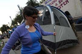 Susan Phelen from San Francisco left the warmth of her San Francisco home to erect a tent that she plans to occupy at Occupy San Francisco in Justin Herman Park Thursday Oct 27, 2011.