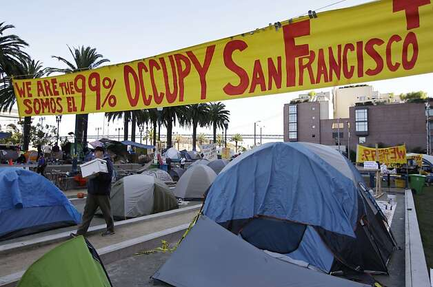 View of an encampment of Occupy San Francisco protest in downtown San Francisco, Wednesday, Oct. 26, 2011. San Francisco officials are warning anti-Wall Street protesters camped out in a city plaza that they face arrest if they continue to stay there around the clock. In a notice distributed on Tuesday, Police Chief Greg Suhr said the protesters in Justin Herman Plaza could be arrested on a variety of sanitation or illegal camping violations although police are not saying when that could occur.  (AP Photo/Paul Sakuma) Photo: Paul Sakuma, AP