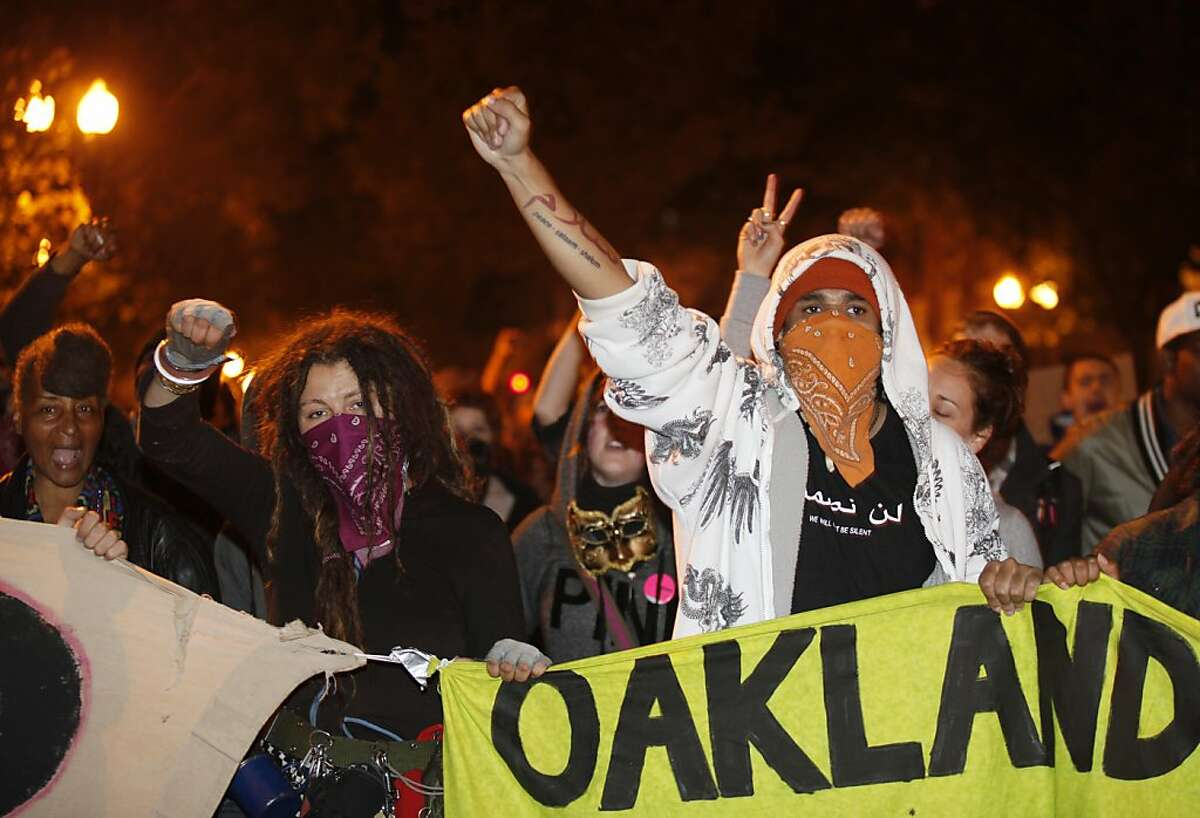 The Occupy Oakland protesters march through streets of Oakland as a part of the Occupy Wall Street movements, near the Oakland City Hall on October 25, 2011 in California. AFP Photo / Kimihiro Hoshino (Photo credit should read KIMIHIRO HOSHINO/AFP/Getty Images)