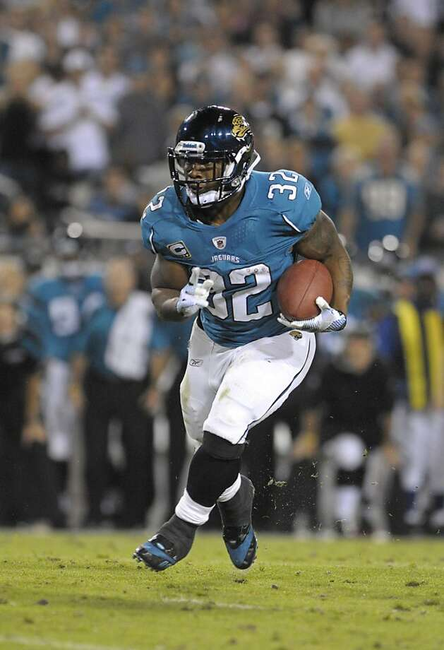 Jacksonville Jaguars running back Maurice Jones-Drew gains yardage against the Baltimore Ravens during the first half of an NFL football game Monday, Oct. 24, 2011, in Jacksonville, Fla. (AP Photo/Phelan M. Ebenhack)     Ran on: 10-25-2011 Baltimore's top-ranked run defense couldn't stop Maurice Jones-Drew, who ran for 105 yards. Photo: Phelan M. Ebenhack, AP