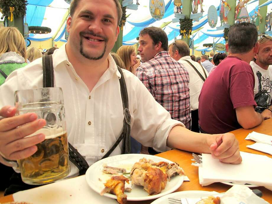 """""""This beer has tasted the same for hundreds of years. I like that,"""" said Ulrich Steinhaus, 34, a Munich banker. He washes down a roasted chicken with beer at Oktoberfest in Munich. Illustrates GERMANY-BEER (category i), by Michael Birnbaum (c) 2011, The Washington Post. Moved Friday, Oct. 7, 2011. (MUST CREDIT: Washington Post photo by Michael Birnbaum) Photo: Birnbaum, The Washington Post"""