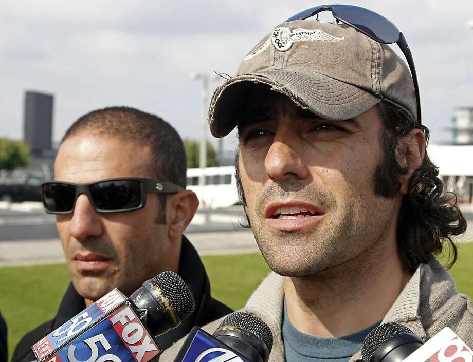 IndyCar drivers Dario Franchitti, right, of Scotland, and Tony Kanaan, of Brazil,  talk about discussions held during a drivers meeting at the Indianapolis Motor Speedway in Indianapolis, Monday, Oct. 24, 2011. (AP Photo/Michael Conroy)  Ran on: 10-25-2011 Dario Franchitti (right), shown with fellow IndyCar driver Tony Kanaan, was &quo;encouraged&quo; by the talks. Ran on: 10-25-2011 Dario Franchitti (right), shown with fellow IndyCar driver Tony Kanaan, was &quo;encouraged&quo; by the talks. Photo: Michael Conroy, AP
