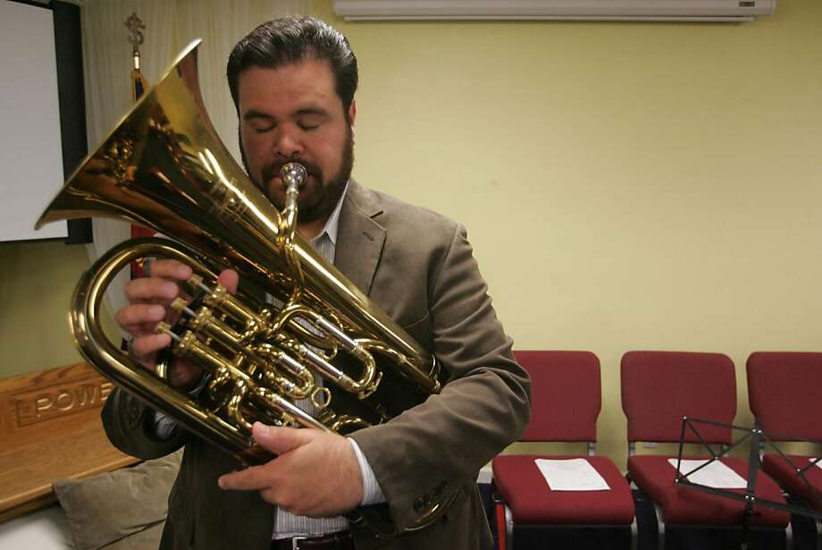 Musician Adrian Quince prepares for a rehearsal on the euphonium with the Golden Gate Brass Band on Thursday, Oct. 20, 2011 in San Rafael, Calif. Photo: Mathew Sumner, Special To The Chronicle
