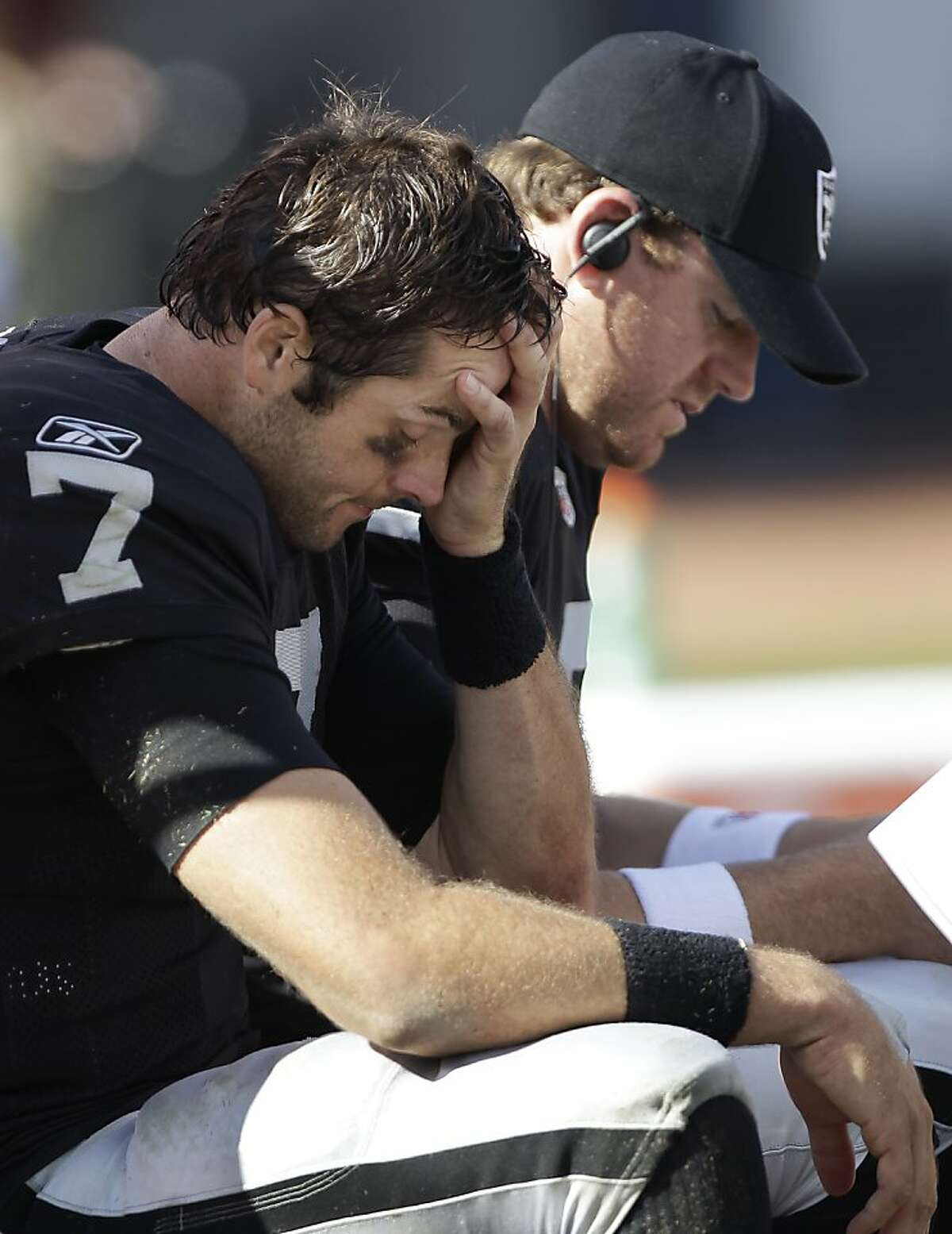 Oakland Raiders quarterback Kyle Boller (7) sits on the bench next to quarterback Carson Palmer in the second quarter of an NFL football game against the Kansas City Chiefs in Oakland, Calif., Sunday, Oct. 23, 2011. (AP Photo/Paul Sakuma)