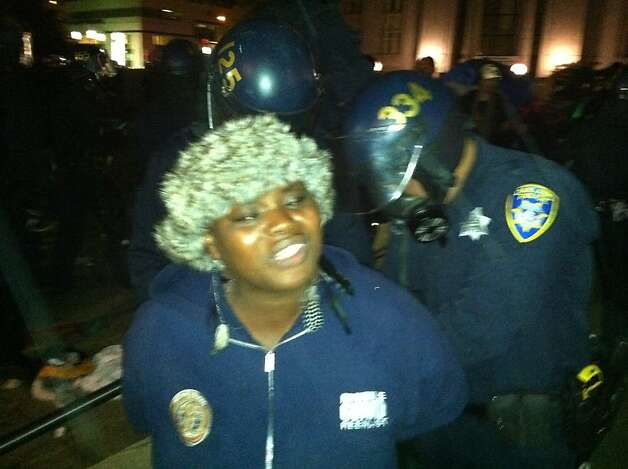 Occupy Oakland protester Aiyahnna Johnson is hauled away by police after police informed her and dozens of others that they couldn't camp in downtown Oakland early on October 25, 2011. Photo: Demian Bulwa, The Chronicle