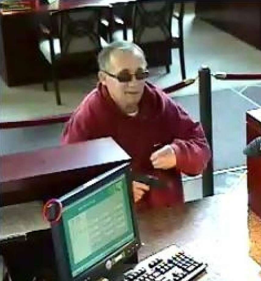 Surveillance camera photos of a bank robber taken at the East West Bank in San Francisco on Oct. 6. Photo: Jhsohn, FBI