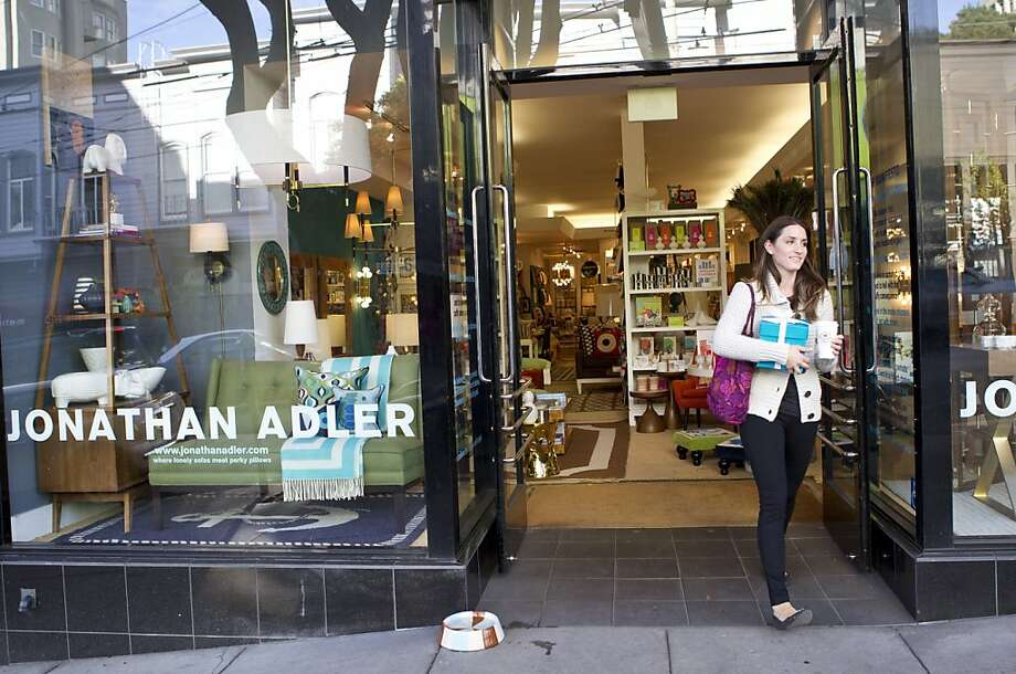 Olivia Beaman steps out onto Fillmore Street after shopping at Jonathan Adler, a furnishings store located at 2133 Fillmore Street in San Francisco, Calif., on Thursday, October 6, 2011. Photo: Laura Morton, Special To The Chronicle