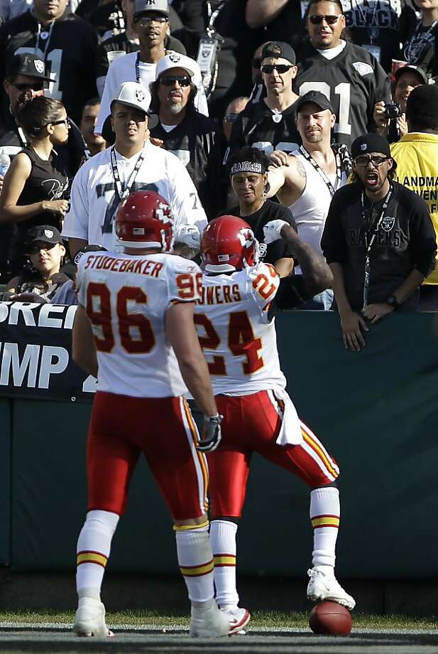 Kansas City Chiefs cornerback Brandon Flowers (24) celebrates between Oakland Raiders fans and outside linebacker Andy Studebaker (96) after returning an interception from Oakland Raiders quarterback Carson Palmer 58 yards for a touchdown in the fourth quarter of an NFL football game in Oakland, Calif., Sunday, Oct. 23, 2011. (AP Photo/Paul Sakuma) Photo: Paul Sakuma, AP