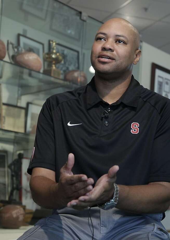 Stanford head coach David Shaw gestures during a NCAA college football news conference in a trophy room on the Stanford campus in Stanford, Calif., Tuesday, Oct. 18, 2011 in preparation for Saturday's game against Washington. (AP Photo/Paul Sakuma)  Ran on: 10-23-2011 David Shaw says this team could exceed last year's team. Ran on: 10-23-2011 David Shaw says this team could exceed last year's team. Photo: Paul Sakuma, AP