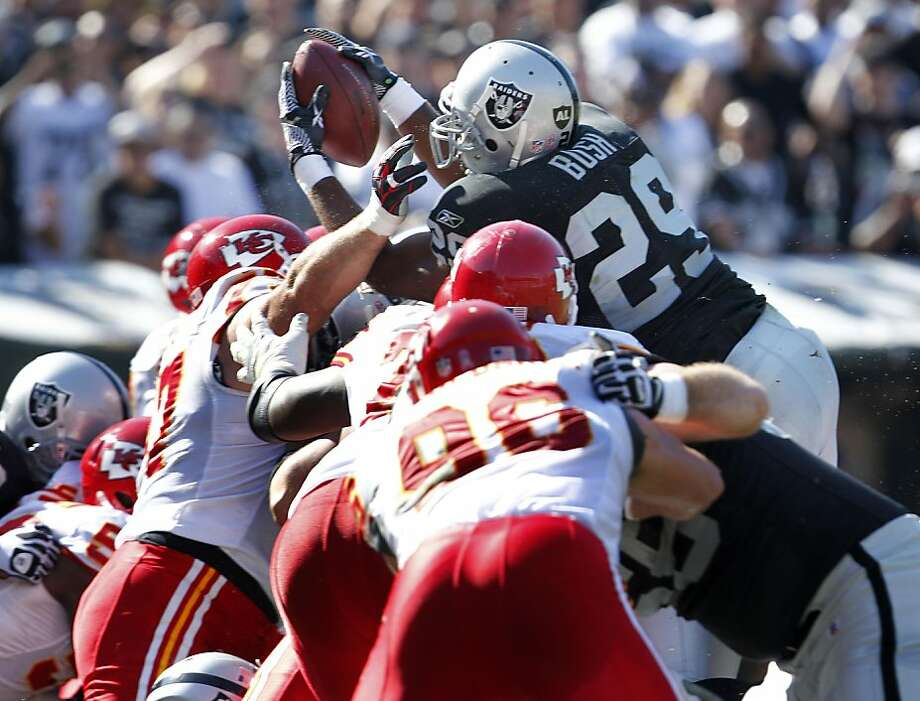 Oakland Raiders Michael Bush tries to score by is held back on the fourth down on the one yard line in the first half of the game against   the Kansas City Chiefs, Sunday October 23, 2011, in Oakland, Calif. Photo: Lacy Atkins, The Chronicle