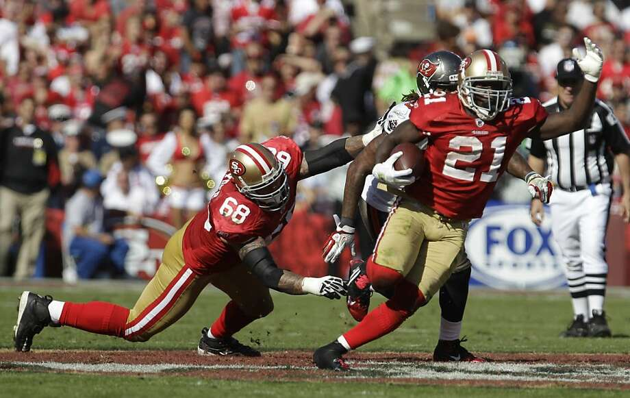 San Francisco 49ers running back Frank Gore, carries the ball as guard Adam Snyder during the third quarter of their NFL football game against the Tampa Bay Buccaneers in San Francisco, Sunday, Oct. 9, 2011. (AP Photo/Paul Sakuma) Photo: Paul Sakuma, AP