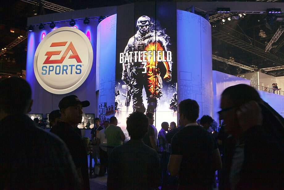 FILE - In this June 8, 2011 file photo, attendees line up at the Electronic Arts booth to play the new Battlefield 3 video game, at the 2011 Electronic Entertainment Expo in Los Angeles. Electronic Arts Inc., reports quarterly financial results Tuesday, July 26, 2011, after the market close. (AP Photo/Damian Dovarganes, file)  Ran on: 07-29-2011 Electronic Arts is accused of conspiring with the NCAA to deprive athletes of compensation when their likenesses are used in video games. Photo: Damian Dovarganes, AP