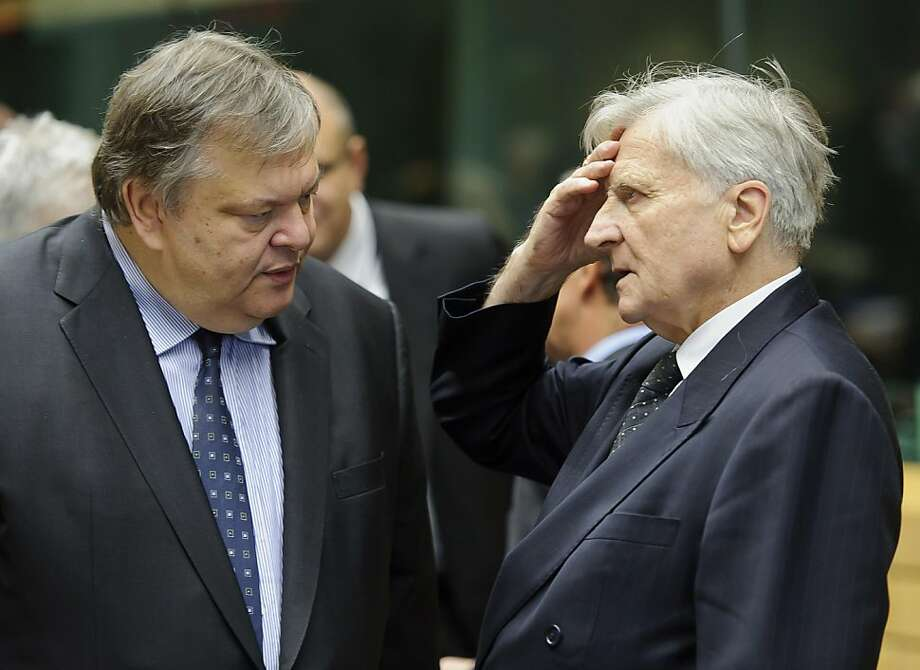 Evangelos Venizelos, Greece's finance minister, left, speaks with Jean-Claude Trichet, president of the European Central Bank (ECB), ahead of the EcoFin finance ministers meeting at the European Council headquarters in Brussels, Belgium, on Saturday, Oct. 22, 2011. France retreated in a clash with Germany over how to expand the power of EuropeÕs bailout fund as finance ministers entered the second of a six-day marathon to stave off a Greek default and shield banks from the fallout. Photographer: Jock Fistick/Bloomberg *** Local Caption *** Evangelos Venizelos; Jean-Claude Trichet Photo: Jock Fistick, Bloomberg