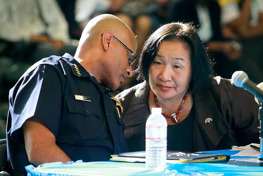 Oakland Mayor Jean Quan has a word with interim Police Chief Howard Jordan during the presentation of a new crime prevention plan at Laney College in Oakland, Calif., on Thursday, October 15, 2011. Ran on: 10-16-2011 Oakland interim Police Chief Howard Jordan confers with Mayor Jean Quan during her crime summit at Laney College, where they announced that agencies will focus on the deadliest areas. Photo: John Storey, Special To The Chronicle