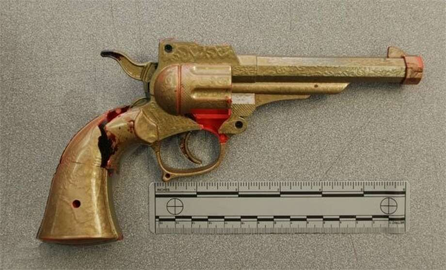 Police say they shot a costumed man when he pulled this replica gun from his waistband. Photo: Courtesy San Jose Police Departm