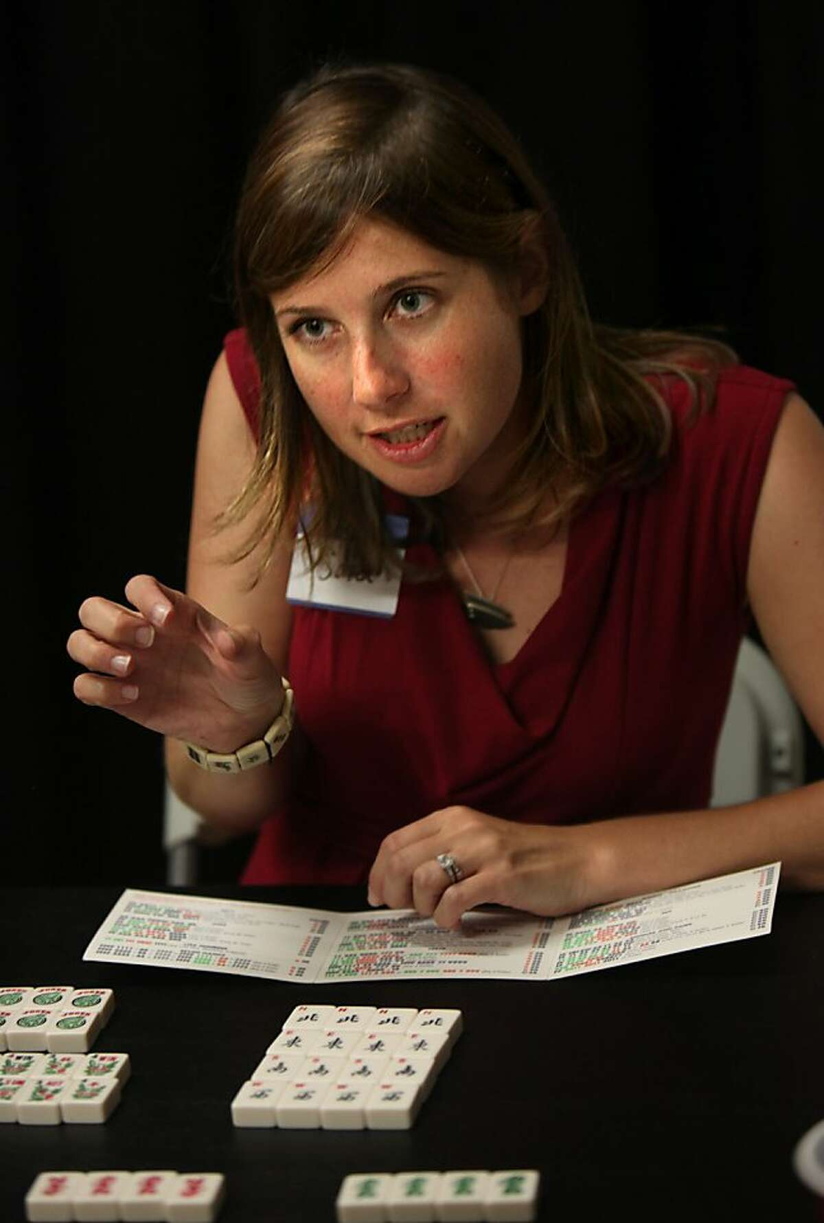 Mahjong enthusiast Sara Linden teaching the game of Mahjong to several beginners at her friend's photo studio in a building at Dogpatch in San Francisco, California, on Tuesday, September 27, 2011.