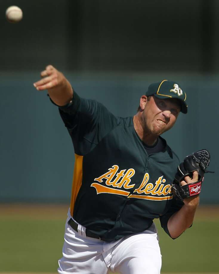 Pitcher Michael Wuertz pitched one inning, and walked one and struck out one in his spring training debut  with the Oakland A's against the Chicago Cubs at Phoenix Municipal Stadium in Phoenix, Ariz. on Tuesday, March 15, 2011. Photo: Paul Chinn, The Chronicle