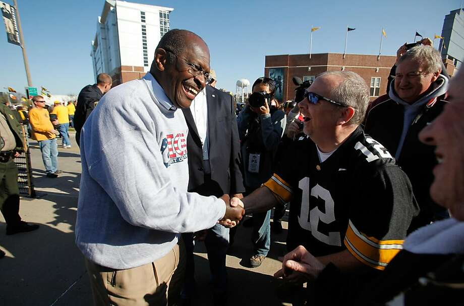 Republican presidential hopeful, businessman Herman Cain, campaigns outside of Kinnick stadium in Iowa City, Iowa, before Iowa's NCAA college football game against Indiana, Saturday, Oct. 22, 2011. About a half-dozen Republican candidates and about 1,000 evangelical activists plan to attend Iowa Faith and Freedom Coalition in Des Moines Saturday night as the Republican presidential campaign continues its search for a more conservative alternative to former Massachusetts Gov. Mitt Romney. (AP Photo/Brian Ray) Ran on: 10-23-2011 Republican presidential hopeful Herman Cain campaigns in Iowa City, Iowa. Photo: Brian Ray, AP