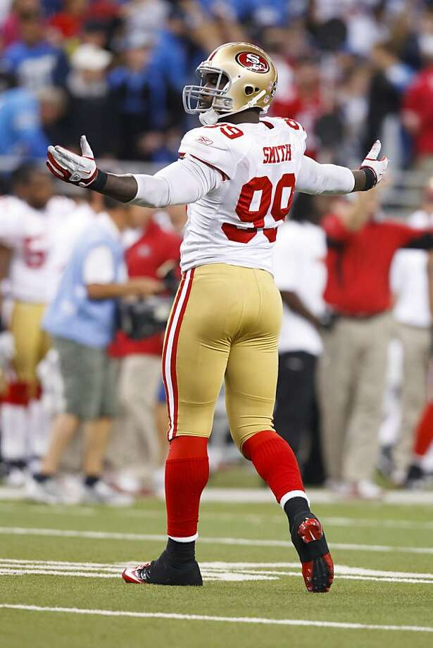 San Francisco 49ers linebacker Aldon Smith (99) celebrates after an NFL football game against the Detroit Lions in Detroit, Sunday, Oct. 16, 2011. San Francisco won 25-19. (AP Photo/Rick Osentoski) Photo: Rick Osentoski, AP