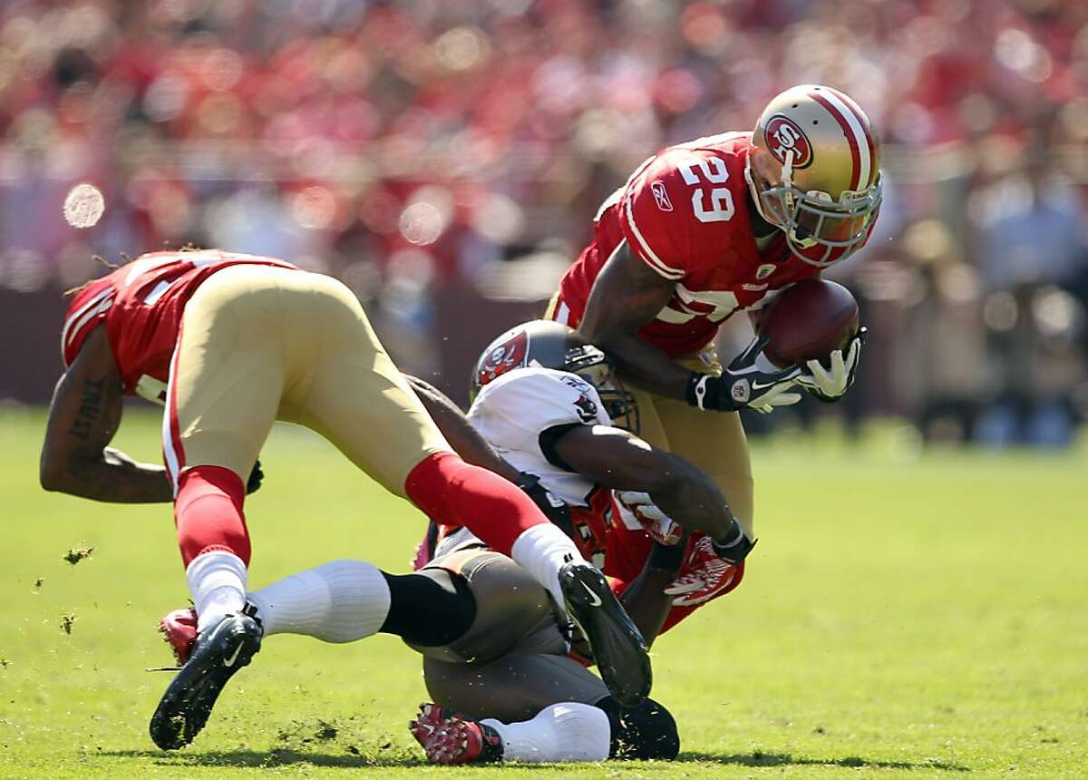 SAN FRANCISCO, CA - OCTOBER 09: Chris Culliver #29 of the San Francisco 49ers intercepts a pass during their game against the Tampa Bay Buccaneers at Candlestick Park on October 9, 2011 in San Francisco, California. (Photo by Ezra Shaw/Getty Images) Ran on: 10-11-2011 Third-round pick Chris Culliver makes his first NFL interception in the second quarter. Ran on: 10-11-2011 Third-round pick Chris Culliver gets his first NFL interception in the second quarter.