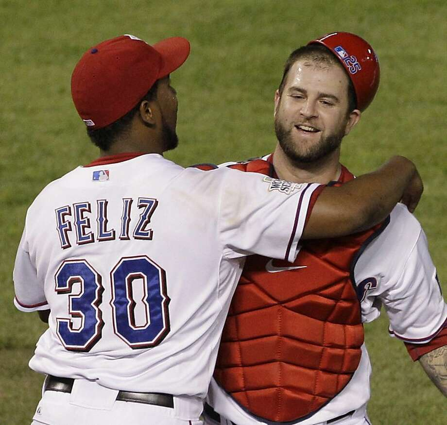 Texas Rangers' Neftali Feliz and Mike Napoli celebrate after Game 5 of baseball's World Series against the St. Louis Cardinals Monday, Oct. 24, 2011, in Arlington, Texas. The Rangers won 4-2 to take a 3-2 lead in the series. (AP Photo/Paul Sancya)  Ran on: 10-25-2011 Rangers closer Neftali Feliz and catcher Mike Napoli, who had the game-winning hit, celebrate after winning Game 5. Ran on: 10-25-2011 Rangers closer Neftali Feliz and catcher Mike Napoli, who had the game-winning hit, celebrate after winning Game 5. Photo: Paul Sancya, AP