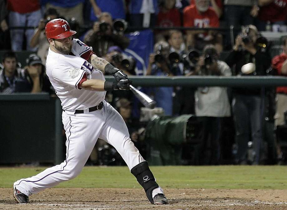 Texas Rangers' Mike Napoli hits a two-run double during the eighth inning of Game 5 of baseball's World Series against the St. Louis Cardinals Monday, Oct. 24, 2011, in Arlington, Texas. (AP Photo/Charlie Riedel)  Ran on: 10-25-2011 Mike Napoli's two-run double in the eighth inning put the Rangers ahead for good in Texas' 4-2 win in Game 5. Ran on: 10-25-2011 Mike Napoli's two-run double in the eighth inning puts the Rangers ahead for good. Photo: Charlie Riedel, AP