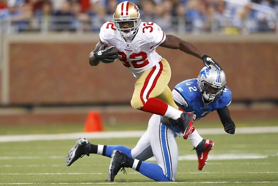 San Francisco 49ers running back Kendall Hunter (32) is tripped up by Detroit Lions strong safety Amari Spievey (42) in the fourth quarter of an NFL football game in Detroit, Sunday, Oct. 16, 2011. (AP Photo/Rick Osentoski)  Ran on: 10-25-2011 Kendall Hunter has a 44-yard run and a 44-yard reception behind Frank Gore. Photo: Rick Osentoski, AP