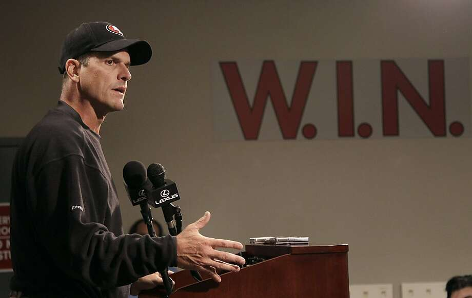 San Francisco 49ers coach Jim Harbaugh speaks to reporters at a news conference at the NFL football team's facility in Santa Clara, Calif., Monday, Oct. 17, 2011. (AP Photo/Jeff Chiu)  Ran on: 10-23-2011 Coach Jim Harbaugh doesn't publicly criticize players and even brings the practice squad along on the 49ers' road trips. Photo: Jeff Chiu, AP