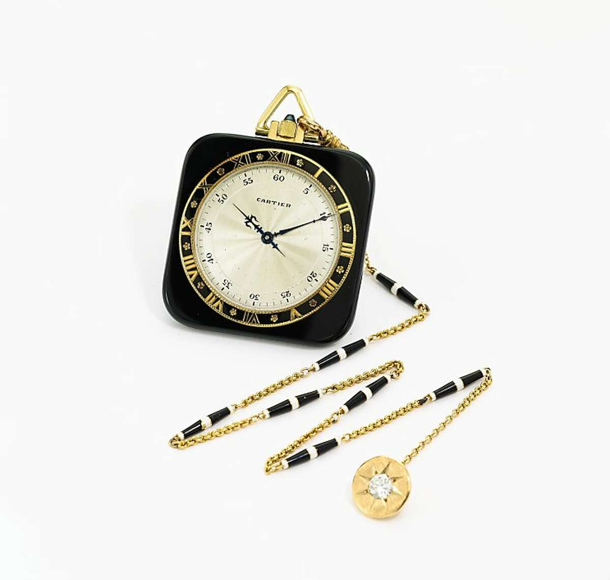 Pieces from the holdings of the late objet d'art collector John Traina of San Francisco will be auctioned at Sotheby's in New York on Dec. 7. Among them: a Cartier/European Watch And Clock, Co., Inc. 18 carat yellow gold, onyx and enamel square open-faced watch, circa 1920 valued at an estimated $8,000-12,000.