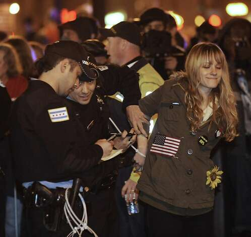 A protester gets arrested during an Occupy Chicago march and protest in Grant Park in Chicago, Sunday, Oct. 23, 2011. Demonstrators of the anti-Wall Street group Occupy Chicago stood their ground in a downtown park and defied police orders to clear the area, prompting police to make more than a dozen arrests early Sunday.  (AP Photo/Paul Beaty) Photo: Paul Beaty, AP