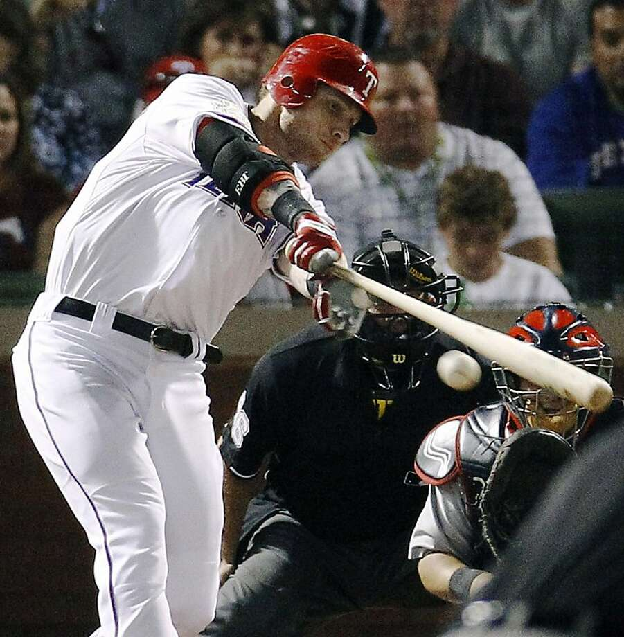 Texas Rangers' Josh Hamilton hits a RBI double during the first inning of Game 4 of baseball's World Series against the St. Louis Cardinals, Sunday, Oct. 23, 2011, in Arlington, Texas. (AP Photo/Eric Gay)   Ran on: 10-24-2011 The Rangers' Josh Hamilton hits an RBI double in the first inning of Game 4. Hamilton, who admits he might have a sports hernia, says he won't get the injury checked until after the Series. Ran on: 10-24-2011 The Rangers' Josh Hamilton hits an RBI double in the first inning of Game 4. Hamilton, who admits he might have a sports hernia, says he won't get the injury checked until after the Series. Photo: Eric Gay, AP