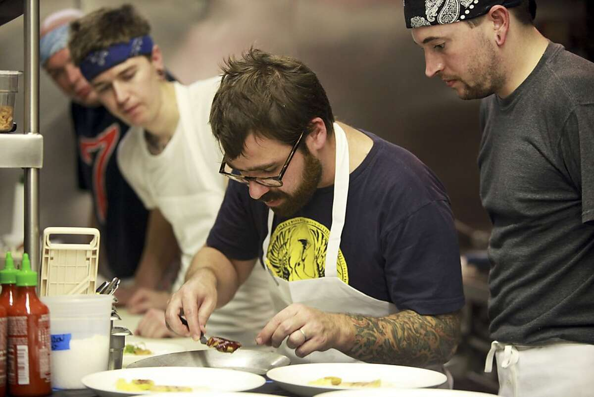 Vinny Dotolo, center, one of the chefs at Animal Restaurant, in Los Angeles, Oct. 14, 2011. In protest of the state's pending ban of foie gras, the fattened liver of a goose or a duck, the restaurant on Friday night served an eight-course foie gras dinner, which cost $175 a person. (Monica Almeida/The New York Times) Ran on: 10-23-2011 Chef Vinny Dotolo (center), at Animal Restaurant in Los Angeles, was part of the fois gras dinner protesting the ban taking effect in July.