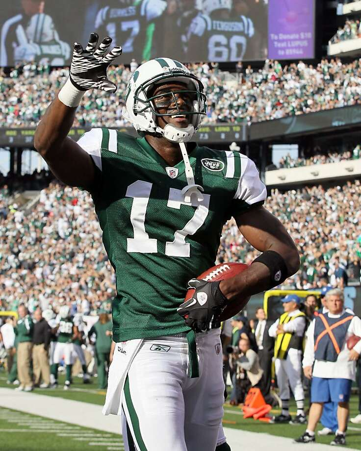Plaxico Burress of the New York Jets celebrates his third-quarter touchdown against the San Diego Chargers. The New York Jets defeated the San Diego Chargers, 27-21, at MetLife Stadium in East Rutherford, New Jersey, on Sunday, October 23, 2011. (Jim McIsaac/Newsday/MCT) Photo: Jim McIsaac, MCT