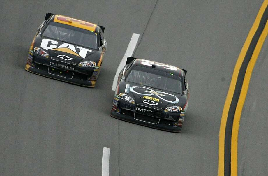Clint Bowyer (33) passes Jeff Burton (31) in Turn 4 on the final lap during the NASCAR Sprint Cup Series auto race at Talladega Superspeedway in Talladega, Ala., Sunday, Oct. 23, 2011. Bowyer won the race. (AP Photo/Jay Alley)  Ran on: 10-24-2011 Clint Bowyer passes teammate Jeff Burton on the final lap to win at Talladega Superspeedway. Ran on: 10-24-2011 Clint Bowyer passes teammate Jeff Burton on the final lap to win at Talladega Superspeedway. Photo: Jay Alley, AP