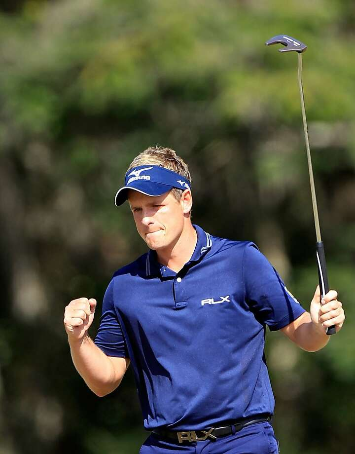 LAKE BUENA VISTA, FL - OCTOBER 23:  Luke Donald of England reacts after making a birdie putt on the 14th hole during the final round of the Children's Miracle Network Classic at Disney's Magnolia course on October 23, 2011 in Lake Buena Vista, Florida.  (Photo by Sam Greenwood/Getty Images) Photo: Sam Greenwood, Getty Images