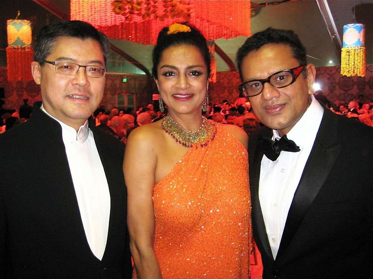 Asian Art Museum Director Jay Xu (left) with Ranjana Khan and her husband, fashion designer Naeem Khan at the Maharaja Gala. Oct 2011. By Catherine Bigelow.