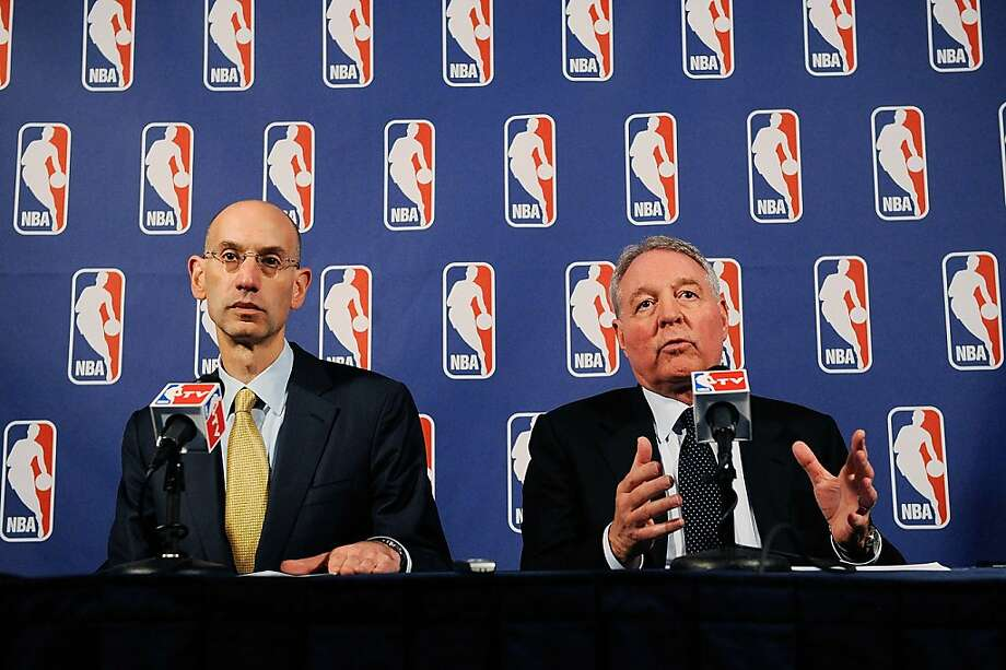 NEW YORK, NY - OCTOBER 20:  Deputy Commissioner Adam Silver (L) and the owner of San Antonio Spurs Peter Holt speak to members of the media after NBA labor negotiations at Sheraton New York Hotel & Towers on October 20, 2011 in New York City. Silver announced that talks have broken down and no further meetings are scheduled.  (Photo by Patrick McDermott/Getty Images) Photo: Patrick McDermott, Getty Images