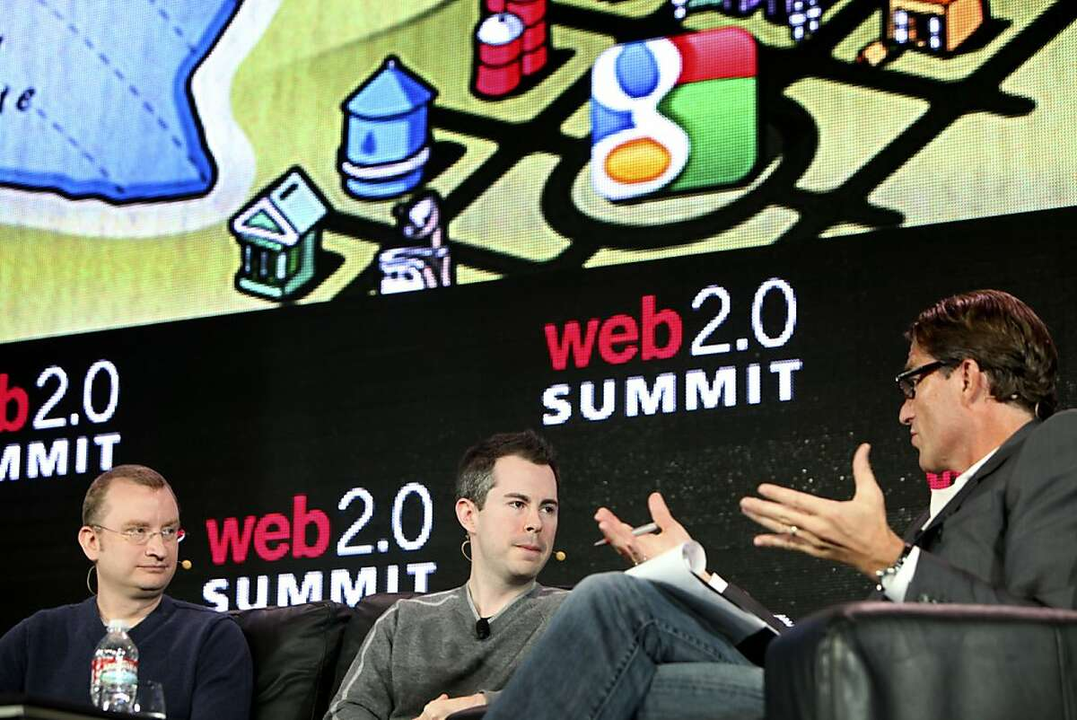 Grahman Spencer, left and Bill Maris of Google Ventures is interviewed by John Battelle, Tuesday October 18, 2011, in front of a crowd at the Web2.0 Summit in San Francisco, Calif.
