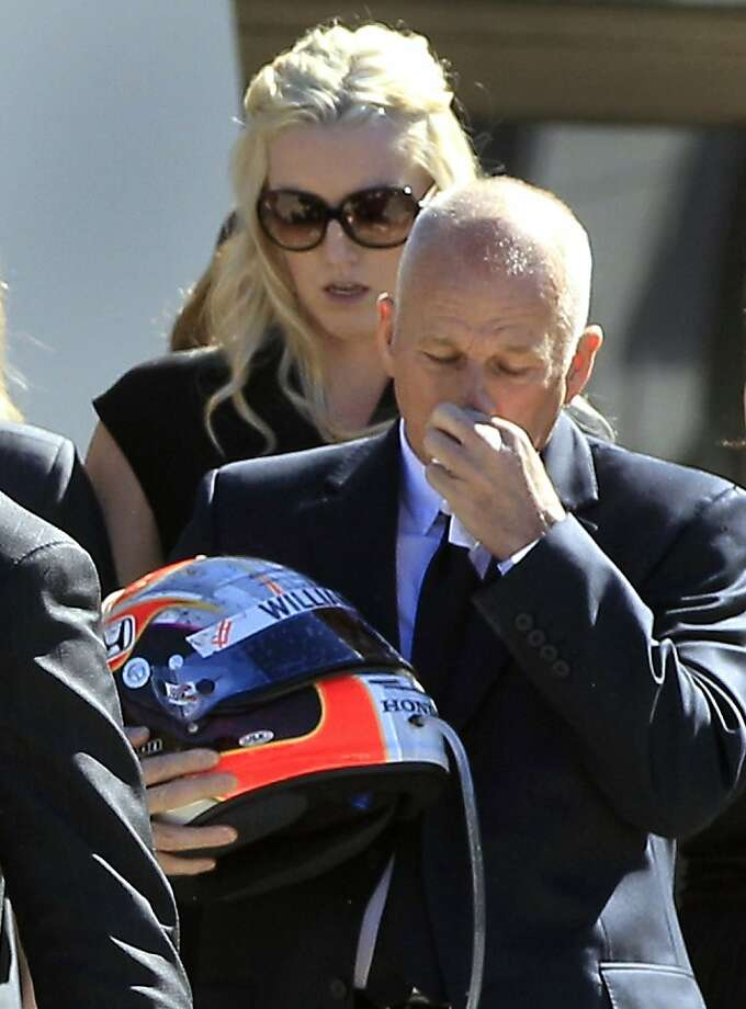 Clive Wheldon, right, father of IndyCar driver Dan Wheldon, wipes his face as he holds his son Dan's helmet after funeral services for Dan Wheldon, Saturday, Oct 22, 2011, in St. Petersburg, Fla.  Dan Wheldon was killed Sunday, Oct. 16, 2011, in a fiery 15-car crash at the Las Vegas Motor Speedway. Following behind is Dan Wheldon's wife Susie. (AP Photo/Chris O'Meara)  Ran on: 10-23-2011 Clive Wheldon (right), father of Dan Wheldon, holds his son's helmet after a funeral. Photo: Chris O'Meara, AP