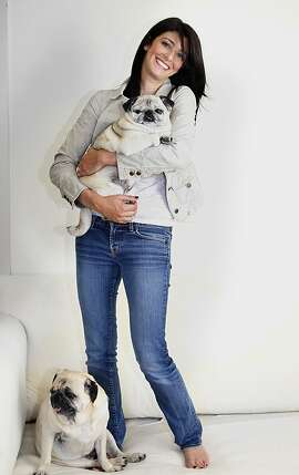 """Founder and CEO of """"The Balm"""" cosmetics company, Marissa Shipman in San Francisco, California, says she's very attached to her dogs, Wheezie (carried), 10 years old, and Buddy (bottom), 11 years old,  on Tuesday, September 27, 2011."""